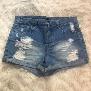 Forever 21 ripped denim mid waisted shorts